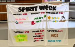 Pride Club made a banner promoting Spirit Week and the Homecoming dance and placed it in the center stairwell at Watertown High School for all students to see.