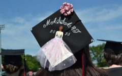 Students in the Class of 2021 added individual design touches to their caps and gowns for the Watertown High School graduation on June 5, 2021, at Victory Field.